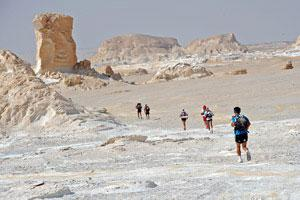 A stunning photo of competitors running through the White Desert in the Sahara Race 2008.